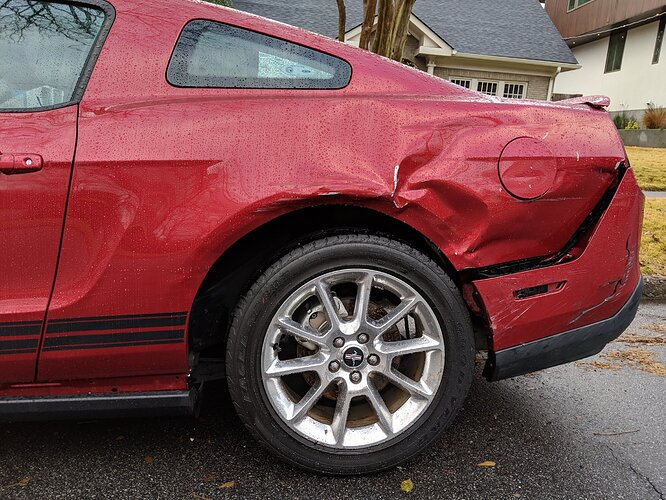 2011-ford-mustang-damage-side-view